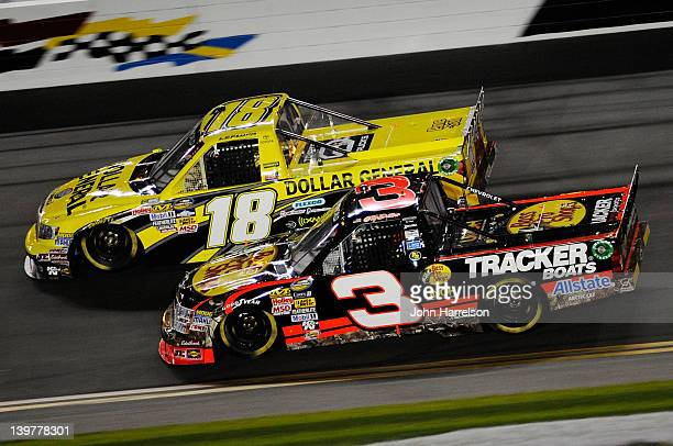 Jason Leffler driver of the Dollar General Toyota and Ty Dillon driver of the Bass Pro Shops/Tracker Boats Chevrolet race during the NASCAR Camping...