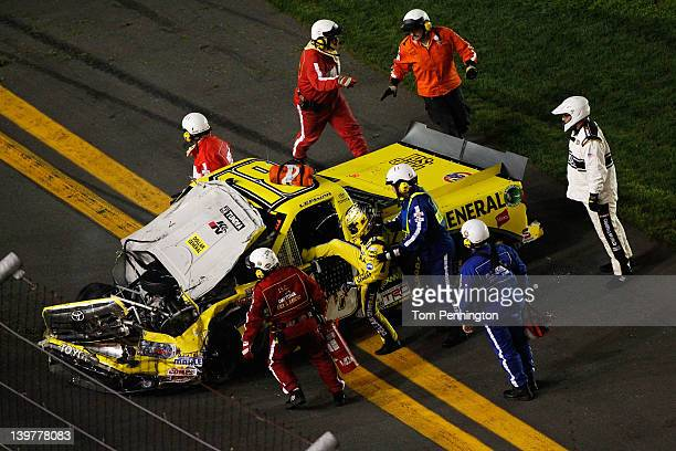 Jason Leffler driver of the Dollar General Toyota is helped from his truck aftrer an on track incident during the NASCAR Camping World Truck Series...