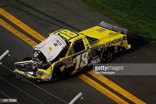 Jason Leffler driver of the Dollar General Toyota sits on the frontstretch after an on track incident during the NASCAR Camping World Truck Series...