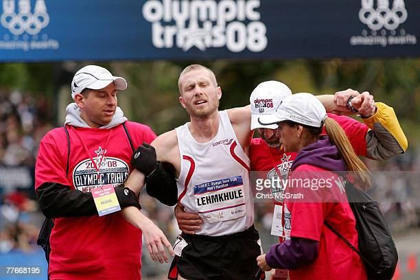 Jason Lehmkuhle is helped by medical staff after collapsing at the finish line during the US Olympic Team Trials Men's Marathon held in Central Park...