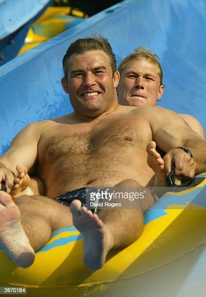 Jason Leonard and Josh Lewsey of England enjoy the waterslide at the Wet 'n' Wild theme park October 28 2003 the Gold Coast Australia
