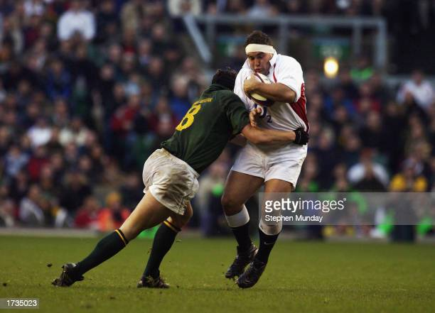 Jason Leonard of England is tackled by Joe Van Niekerk of South Africa during the Investec Challenge match between England and South Africa held on...