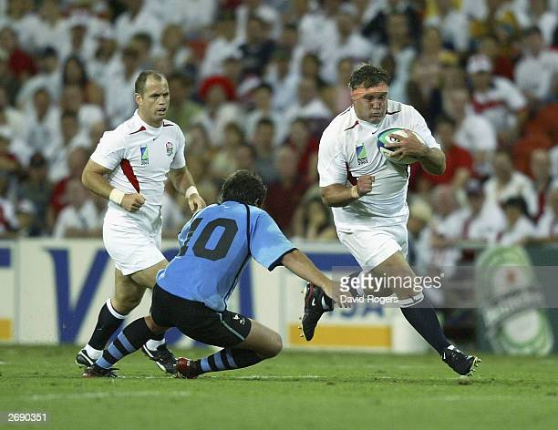 Jason Leonard, of England takes on Sebastian Aguirre of Uruguay during the Rugby World Cup Pool C match between England and Uruguay at Suncorp...