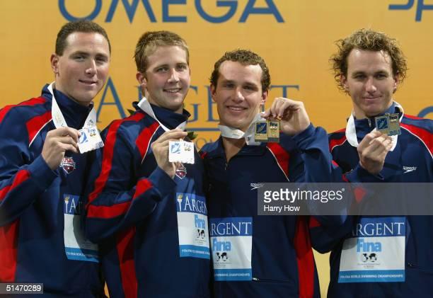 Jason Lezak, Ian Crocker, Brendan Hansen and Aaron Peirsol of USA show off their gold medals winning the Men's 4 x 100 Medley Relay final in a world...