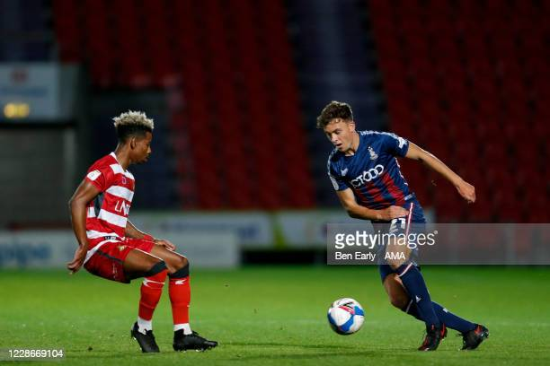 Jason Lokilo of Doncaster Rovers and Reece Staunton of Bradford City during the EFL Trophy match between Doncaster Rovers v Bradford City at Keepmoat...