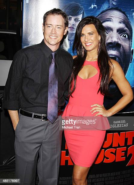 Jason London and Natalie Burn arrive at the Los Angeles premiere of 'A Haunted House 2' held at Regal Cinemas LA Live on April 16 2014 in Los Angeles...
