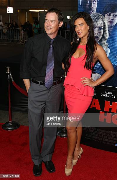 Jason London and Natalie Burn attend 'A Haunted House 2' Los Angeles premiere held at Regal Cinemas LA Live on April 16 2014 in Los Angeles California