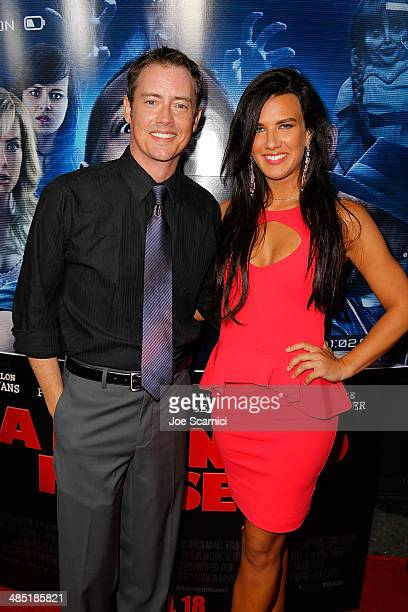 Jason London and Natalie Burn walk the 'A Haunted House 2' Los Angeles Premiere Red Carpet at Regal Cinemas LA Live on April 16 2014 in Los Angeles...
