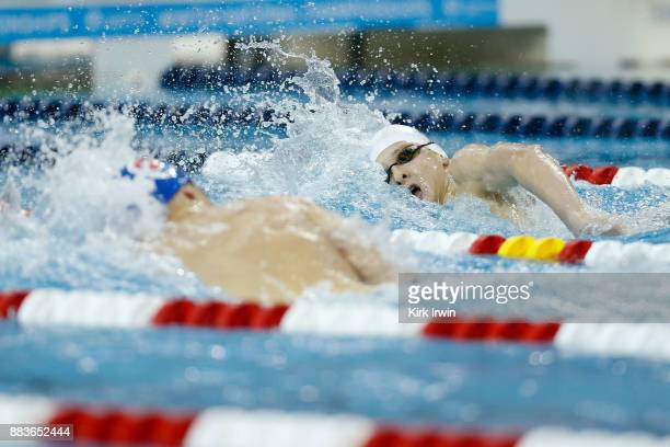 Jason Louser of Long Island Aquatic Club and Sean Conway of Nation's Capital Swim Club compete during heat one of the prelims of the men's 400...