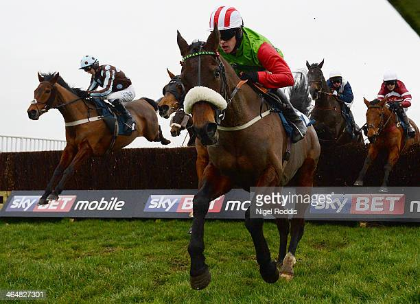 Jason Maguire riding Honest John competes in the Sky Bet 'Home of the Price Boost' Handicap Steeple Chase at Doncaster racecourse on January 24 2014...
