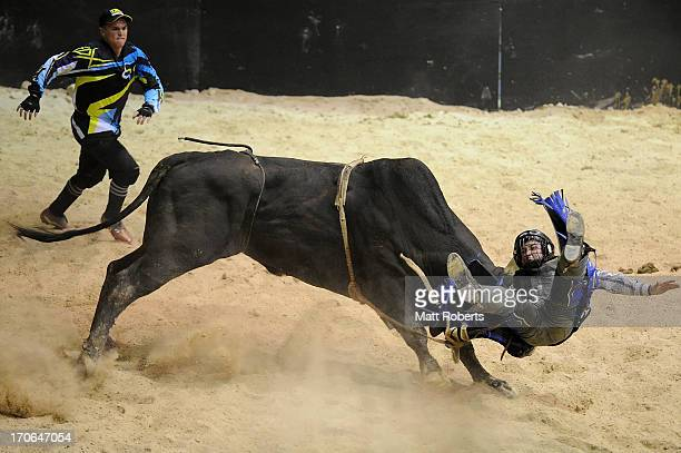 Jason Mara of Bouldercombe competes in the Bull Ride during the National Rodeo Finals on June 16 2013 on the Gold Coast Australia
