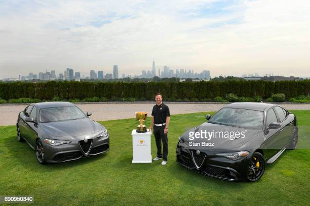Jason Marchioni Alfa Romeo Head of Entertainment Marketing Media Events poses with two Alfa Romeo Giulia vehicles during the Presidents Cup...