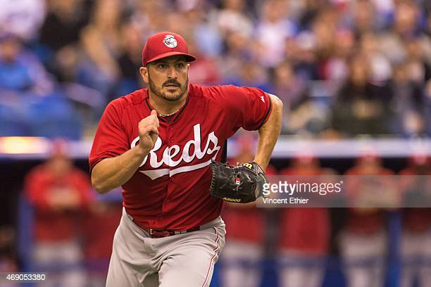 Jason Marquis of the Cincinnati Reds runs to first base in the first inning during the exhibition game against the Toronto Blue Jays at Olympic...