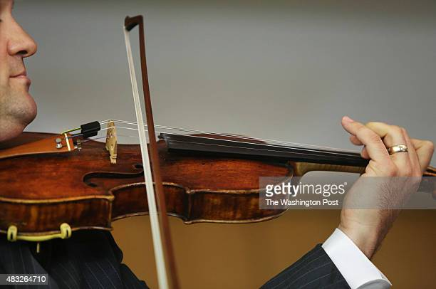 Jason Masimore assistant US prosecutor and violinist plays violin as another valuable violin a Stradivarius just recovered after being stolen in 1980...