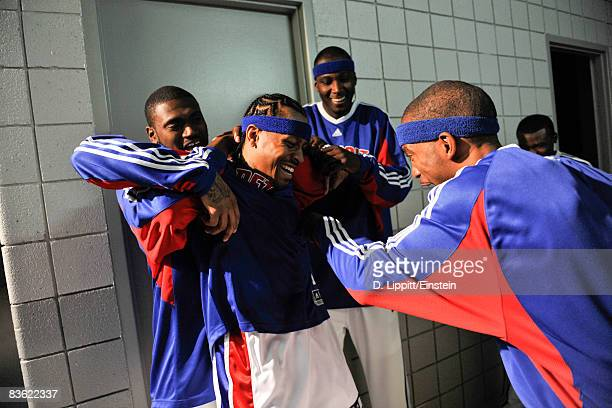 Jason Maxiell Kwame Brown and Richard Hamilton greet Allen Iverson of the Detroit Pistons at his first home game against the Boston Celtics on...