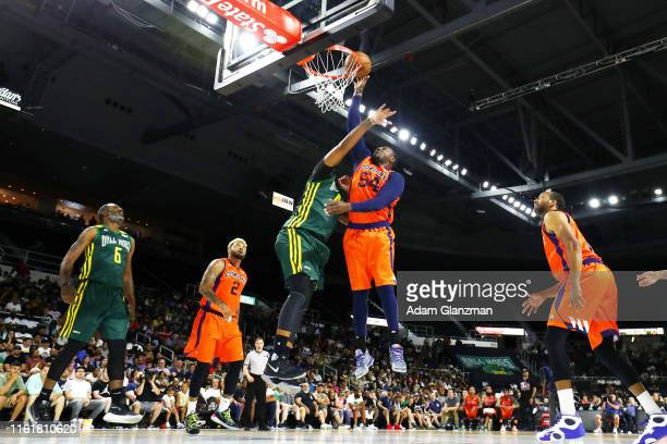 Jason Maxiell of 3's Company drives to the basket against the Ball Hogs during week four of the BIG3 three on three basketball league at Dunkin'...