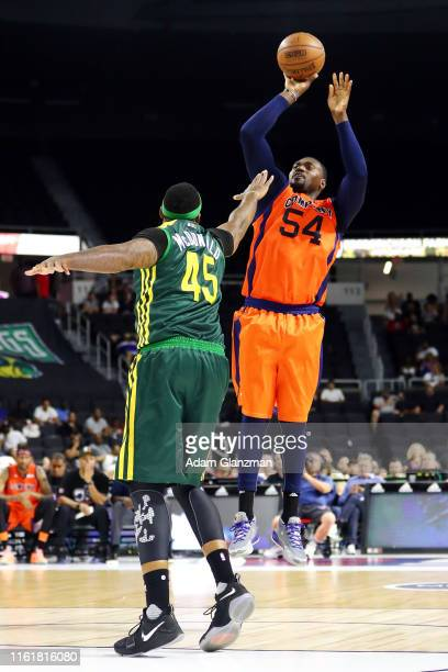 Jason Maxiell of 3's Company shoots the ball against Will McDonald of the Ball Hogs during week four of the BIG3 three on three basketball league at...