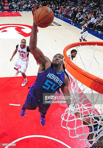 Jason Maxiell of the Charlotte Hornets dunks against the Atlanta Hawks during the game on April 10 2015 at Philips Arena in Atlanta Georgia NOTE TO...