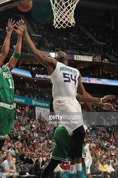 Jason Maxiell of the Charlotte Hornets goes for the rebound against Evan Turner of the Boston Celtics during the game at the Time Warner Cable Arena...