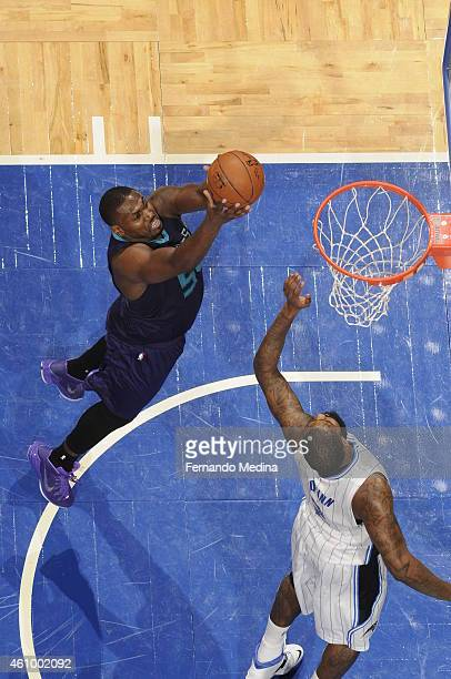 Jason Maxiell of the Charlotte Hornets goes to the basket against the Orlando Magic on January 3 2015 at Amway Center in Orlando Florida NOTE TO USER...