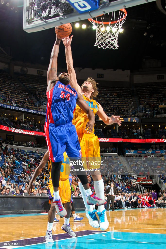 Jason Maxiell #54 of the Detroit Pistons rises for a dunk against Robin Lopez #15 of the New Orleans Hornets on March 1, 2013 at the New Orleans Arena in New Orleans, Louisiana.