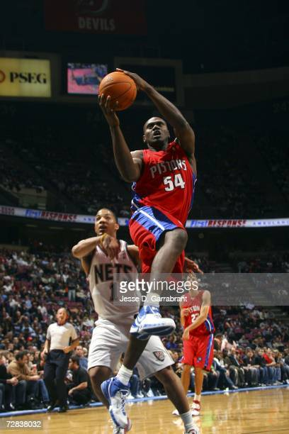 Jason Maxiell of the Detroit Pistons shoots against Marcus Williams of the New Jersey Nets on December 16 2006 at the Continental Airlines Arena in...
