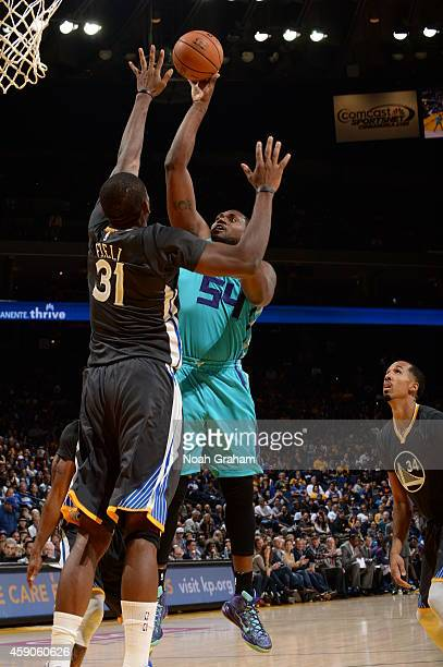 Jason Maxiell of the Golden State Warriors takes a shot against Charlotte Hornets on November 15 2014 at Oracle Arena in Oakland California NOTE TO...