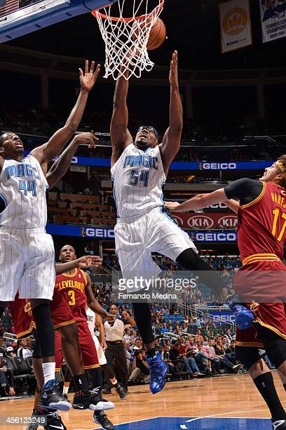 Jason Maxiell of the Orlando Magic goes up for the shot against the Cleveland Cavaliers during the game on December 13 2013 at Amway Center in...