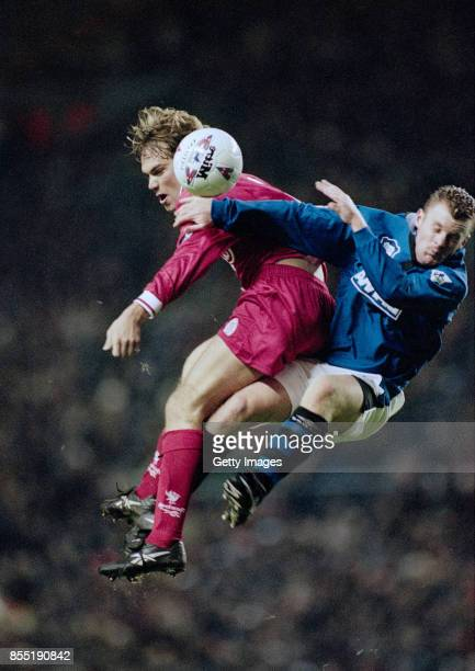 Jason McAteer challenges Graham Stuart of Everton during a Premier League match at Anfield on November 19 1996 in Liverpool England