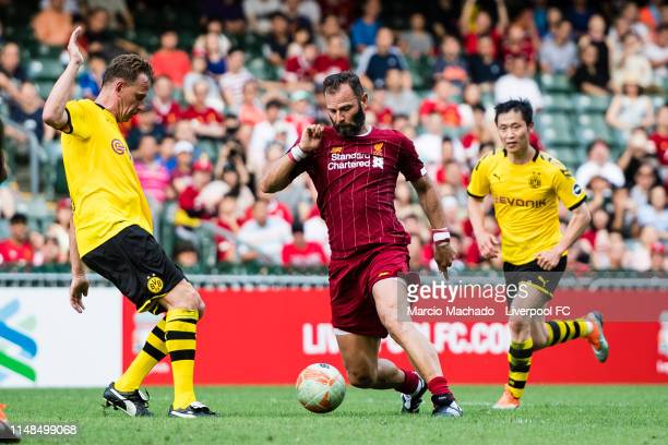 Jason McAteer of Liverpool FC fights for the ball with Jorg Heinrich of Borussia Dortmund during the match between Liverpool Legend and Borussia...