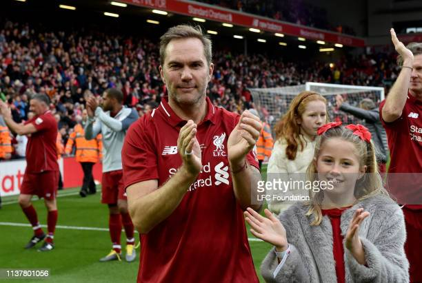 Jason McAteer of Liverpool FC Legends showing his appreciation to the fans at the end of the friendly match between Liverpool FC Legends and AC Milan...
