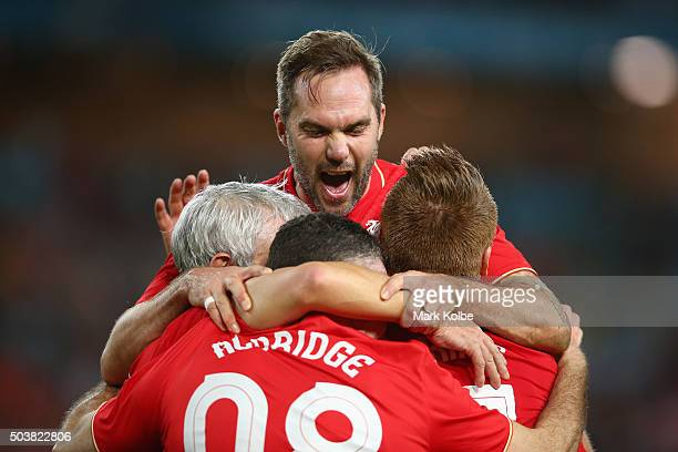 Jason McAteer of the Liverpool FC Legends jumps to celebrate with his team after John Aldridge of the Liverpool FC Legends scored a goal during the...