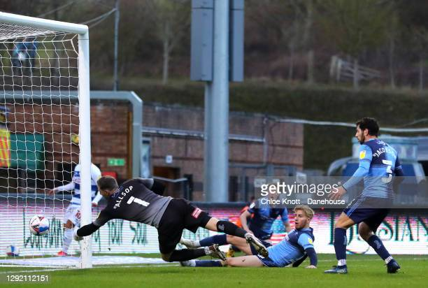 Jason McCarthy of Wycombe Wanderers scores an own goal during the Sky Bet Championship match between Wycombe Wanderers and Queens Park Rangers at...