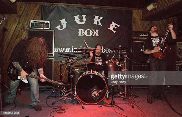 Jason McCash 'Iron' Bob Fouts and Karl Simon of The Gates Of Slumber performs at Indy's Jukebox on January 11 2013 in Indianapolis Indiana