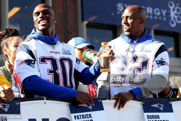 Jason McCourty of the New England Patriots and Devin McCourty celebrate on Cambridge street during the New England Patriots Victory Parade on...