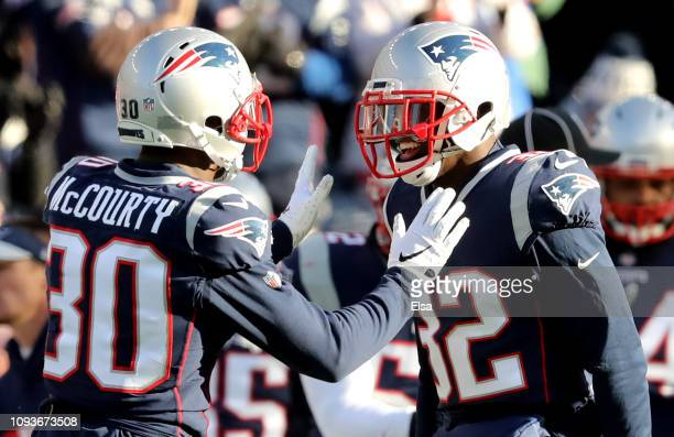 Jason McCourty of the New England Patriots and Devin McCourty react during the second quarter in the AFC Divisional Playoff Game against the Los...