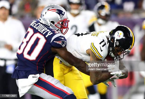 Jason McCourty of the New England Patriots attempts to tackle Donte Moncrief of the Pittsburgh Steelers during the game at Gillette Stadium on...