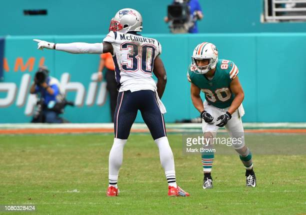 Jason McCourty of the New England Patriots in action against Danny Amendola of the Miami Dolphins at Hard Rock Stadium on December 9 2018 in Miami...