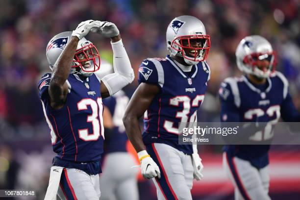 Jason McCourty of the New England Patriots reacts with teammates during the second half against the Minnesota Vikings at Gillette Stadium on December...