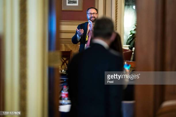 Jason Miller applauds as former President Donald Trump's defense lawyers return to their meeting room following the conclusion of the fourth day of...
