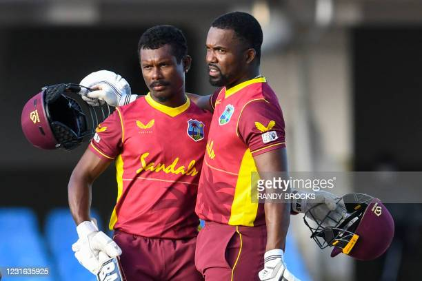 Jason Mohammed and Darren Bravo of West Indies celebrate winning the 1st ODI match between West Indies and Sri Lanka at Vivian Richards Cricket...