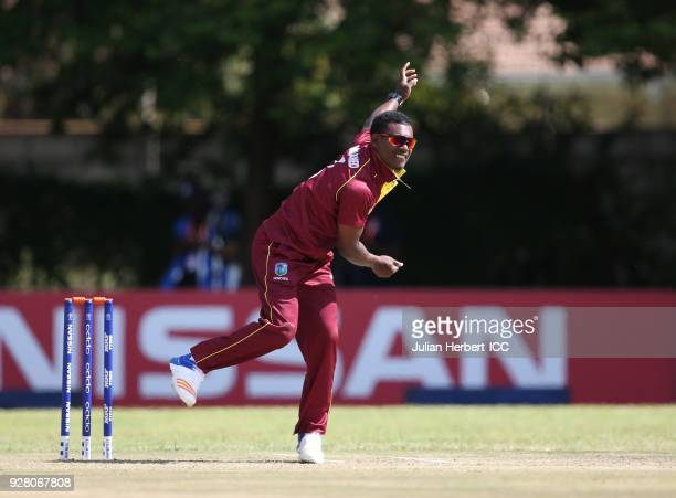 Jason Mohammed of The West Indies bowls during The ICC Cricket World Cup Qualifier between The West Indies and The UAE at The Old Hararians Ground on...