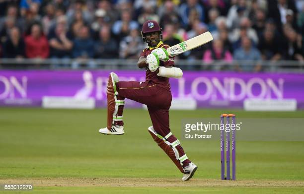 Jason Mohammed of the West Indies hits a boundary during the 3rd Royal London One Day International match between England and the West Indies at The...