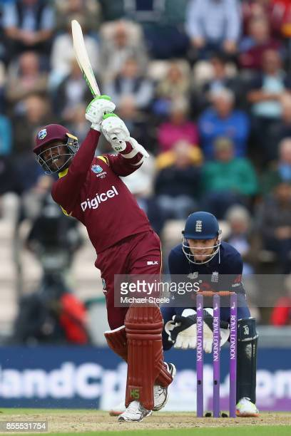 Jason Mohammed of West Indies hits a six over long off from the bowling of Moeen Ali as wicketkeeper Jos Buttler looks on during the 5th Royal London...
