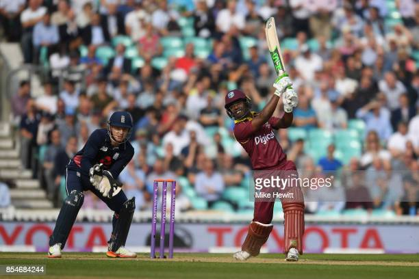 Jason Mohammed of West Indies hits out as wicketkeeper Jos Buttler of England looks on during the 4th Royal London One Day International between...