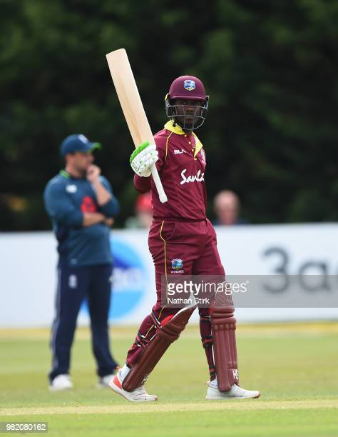 Jason Mohammed of West Indies raises his bat after scoring 50 runs during the TriSeries International match between England Lions and West Indies A...