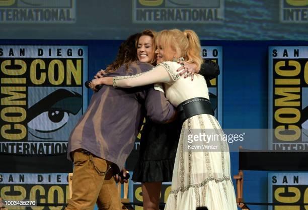 Jason Momoa Amber Heard and Nicole Kidman embrace onstage at the Warner Bros 'Aquaman' theatrical panel during ComicCon International 2018 at San...