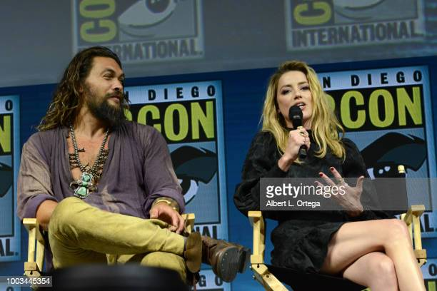 Jason Momoa and Amber Heard speak onstage at the Warner Bros 'Aquaman' theatrical panel during ComicCon International 2018 at San Diego Convention...
