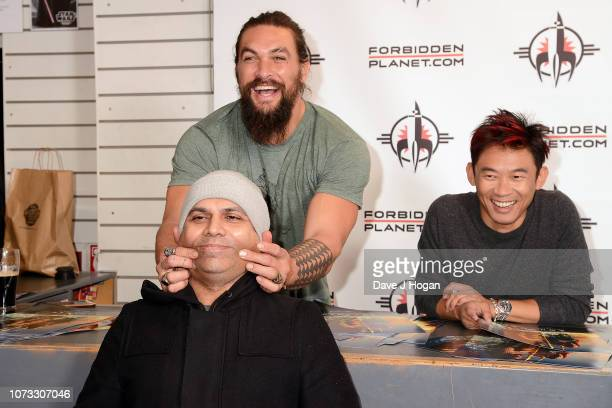 Jason Momoa and director James Wan attend the 'Aquaman' Meet And Greet At Forbidden Planet on November 27 2018 in London England