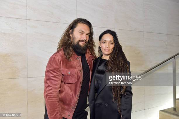 Jason Momoa and Lisa Bonet attend Tom Ford Autumn/Winter 2020 Runway Show at Milk Studios on February 07 2020 in Los Angeles California